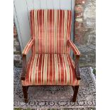 A REGENCY STYLE OPEN ARMCHAIR Upholstered in a cut velvet fabric with acanthus carved arms. (62cm