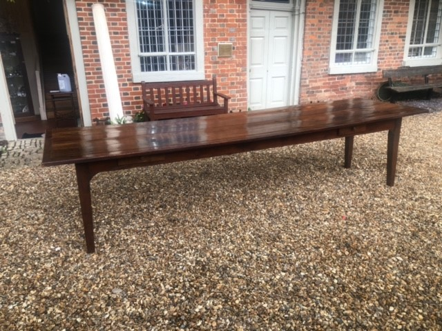 AN 18TH/19TH CENTURY FRENCH FRUITWOOD REFECTORY TABLE The four plank top above four drawers,