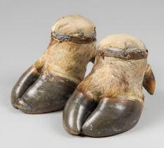 A LATE 19TH CENTURY PAIR OF TAXIDERMY BUFFALO FOOT PIN CUSHIONS/DOORSTOPS. The largest (h 15.5cm x w
