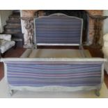 A 19TH CENTURY FRENCH PAINTED WOODEN DOUBLE BED The scrolled frame carved with floral decoration,