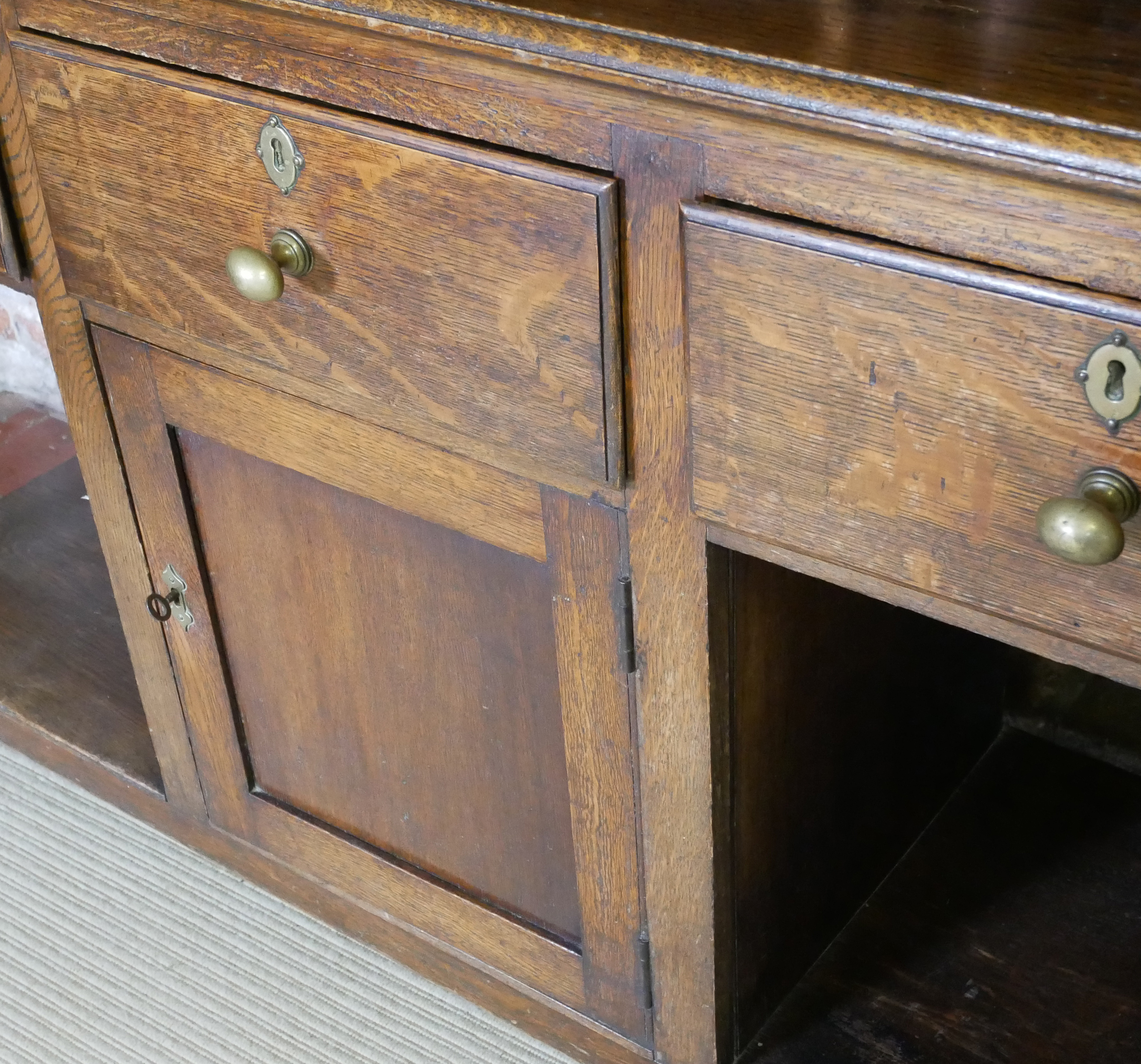 A 19TH CENTURY OAK DRESSER With three drawers above a central cupboard, on square legs. (152cm x - Image 5 of 7