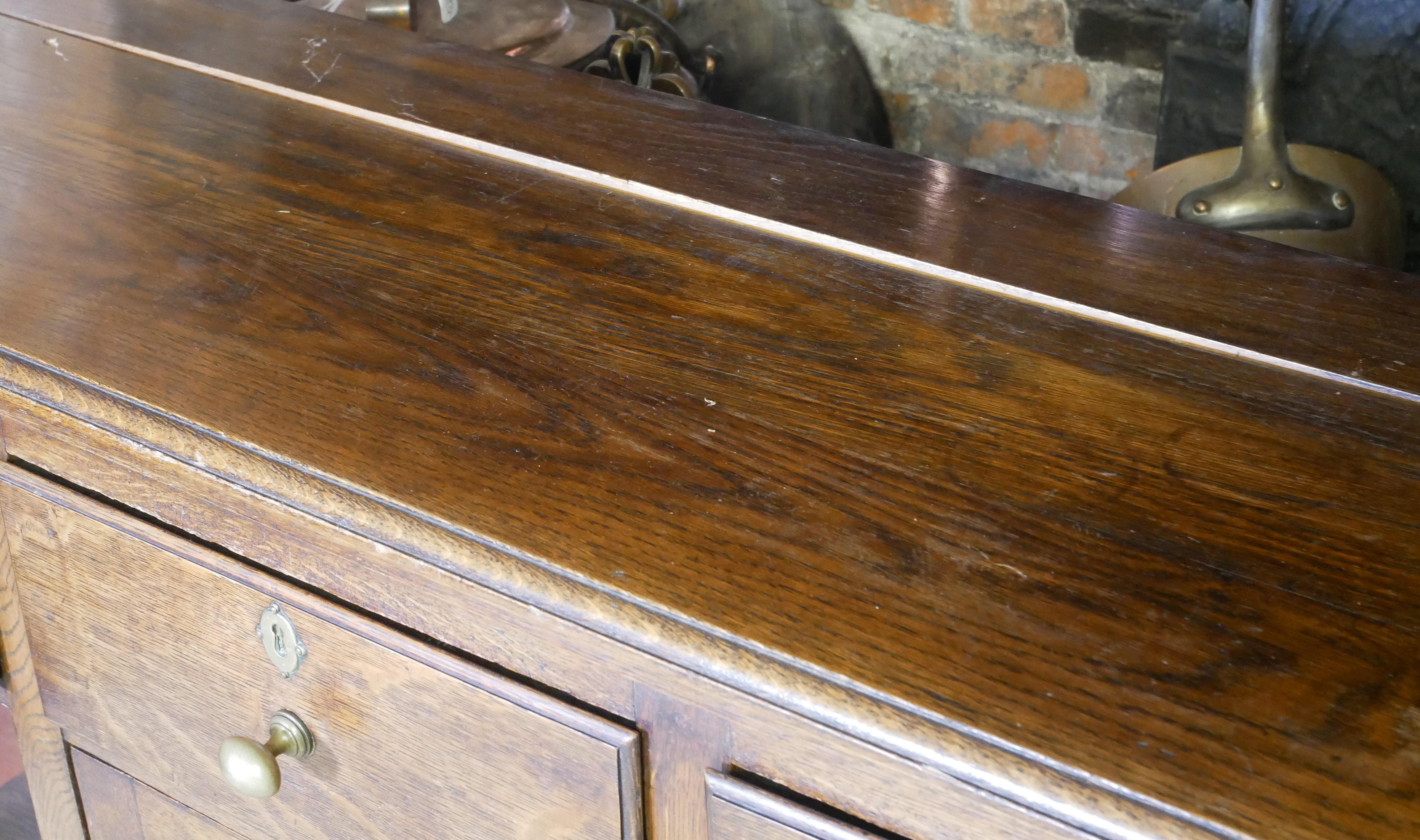 A 19TH CENTURY OAK DRESSER With three drawers above a central cupboard, on square legs. (152cm x - Image 2 of 7