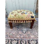 A TAPESTRY UPHOLSTERED STOOL Decorated with butterflies, on square tapering legs. (46cm x 35cm x