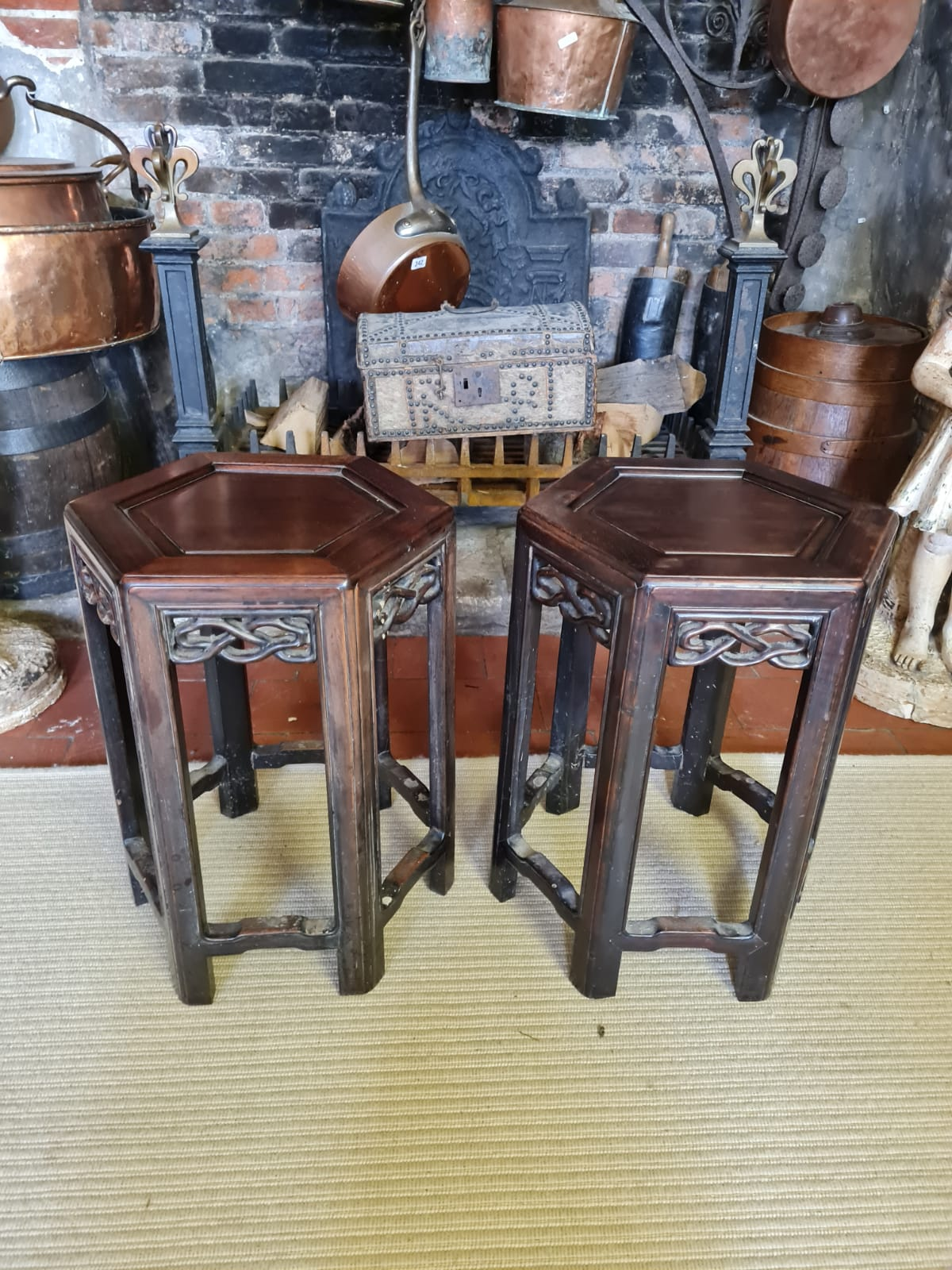A PAIR OF 19TH CENTURY CHINESE HARDWOOD HEXAGONAL OCCASIONAL TABLES With pierced fretwork apron,