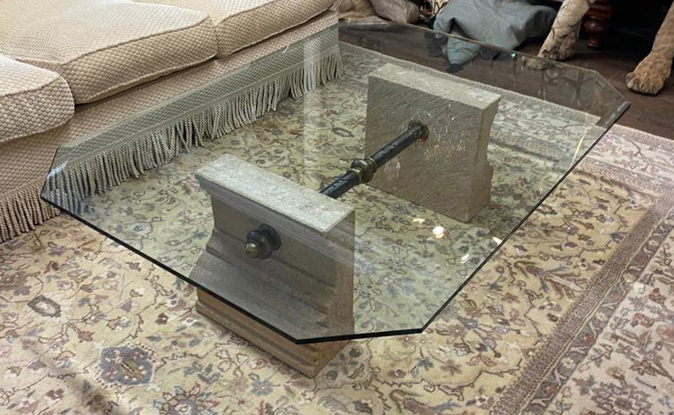 A 20TH CENTURY COFFEE TABLE With clear bevelled glass top supported on carved stone plinths, - Image 2 of 2