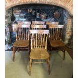 A SET OF SEVEN LATE 19TH CENTURY ASH AND ELM STICK BACK CHAIRS Having solid seats, on turned legs