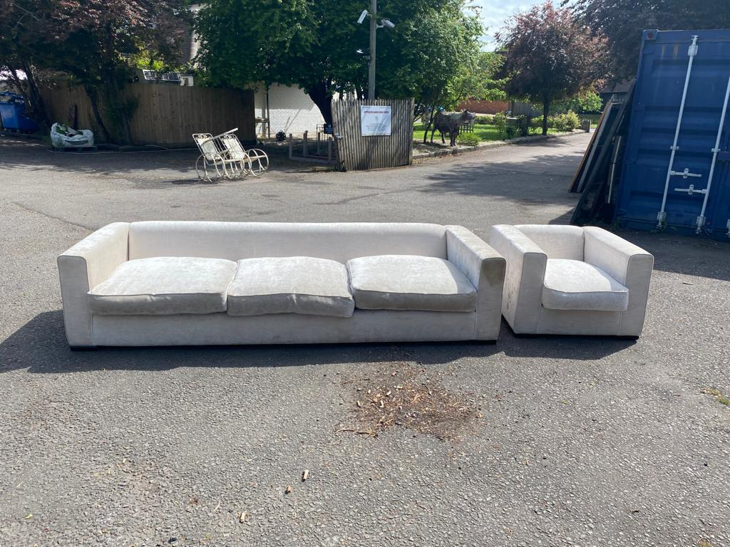 A LARGE CONTEMPORARY CREAM VELVET UPHOLSTERED THREE SEATER SETTEE, along with matching armchair