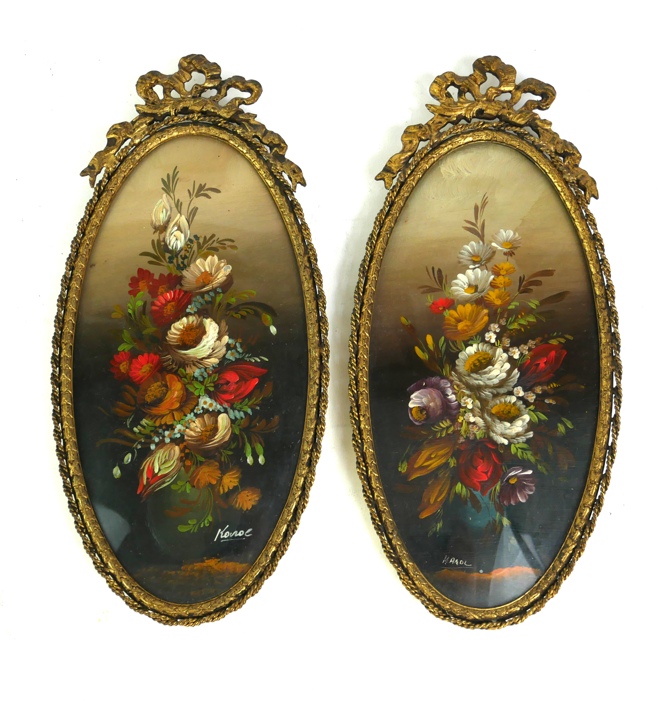 A PAIR OF 20TH CENTURY OVAL OILS ON CARD, STILL LIFE STUDIES With hand painted floral arrangement,