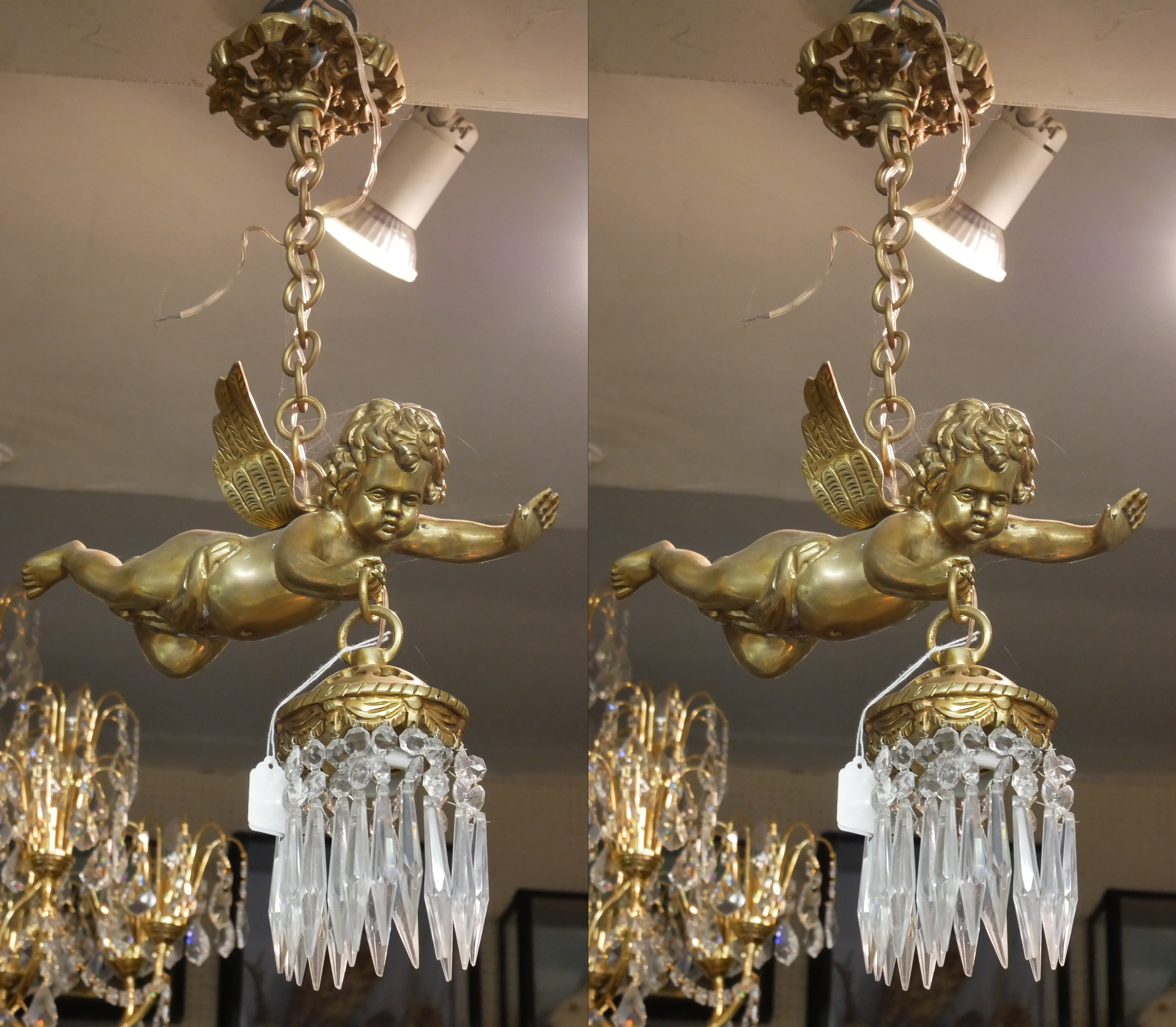 A PAIR OF DECORATIVE GILT BRONZE HANGING CHERUB CHANDELIERS Each holding a single light with crystal