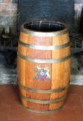 A LATE 19TH/EARLY 20TH CENTURY BRASS BOUND OAK BARREL STICK STAND Decorated with a coat of arms. (