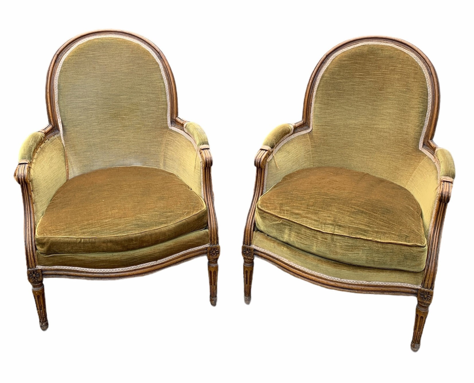 A PAIR OF LOUIS XV DESIGN CARVED WOOD AND UPHOLSTERED BERGERE ARMCHAIRS Raised on fluted legs.