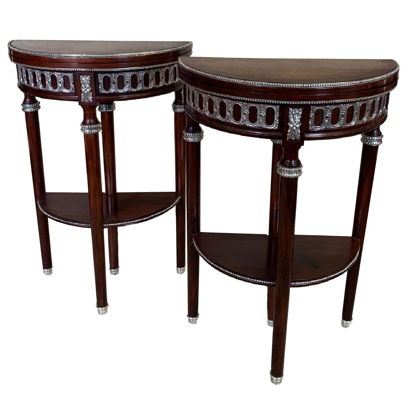 A PAIR OF EARLY 20TH CENTURY LOUIS XVI STYLE AMBOYNA AND MAHOGANY DEMILUNE CARD TABLES The hinge