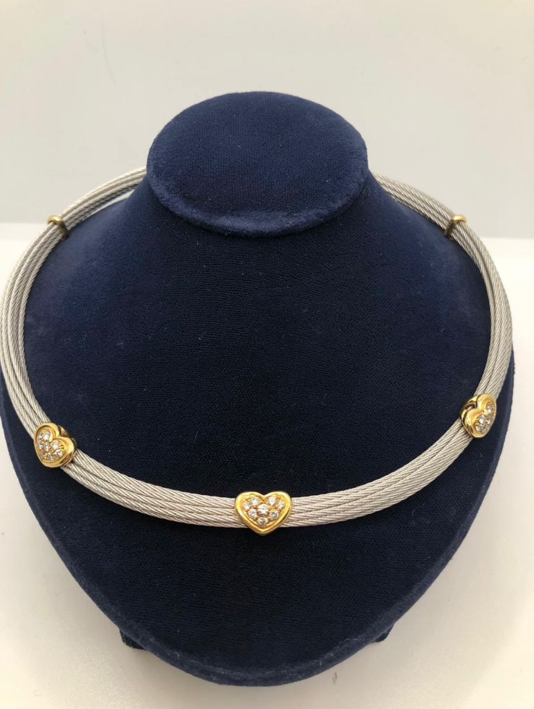 FRED PARIS, A SILVER AND 18CT YELLOW GOLD COLLAR NECKLACE PAVÉ SET WITH DIAMOND HEARTS.