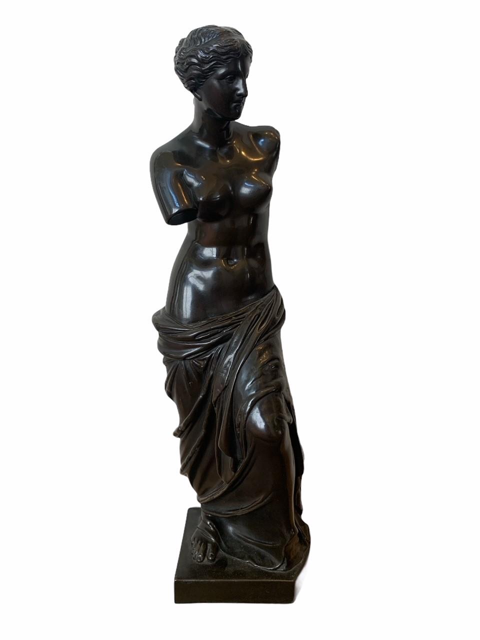 A 19TH CENTURY BRONZE CLAD STATUE OF A NEOCLASSICAL SEMINUDE FEMALE. (h 48cm x d 10.5cm x w 13cm)