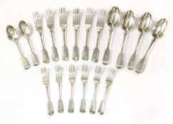 A part set of Victorian silver fiddle pattern cutlery