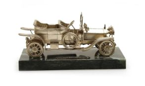 A silver scale model of a Rolls Royce,
