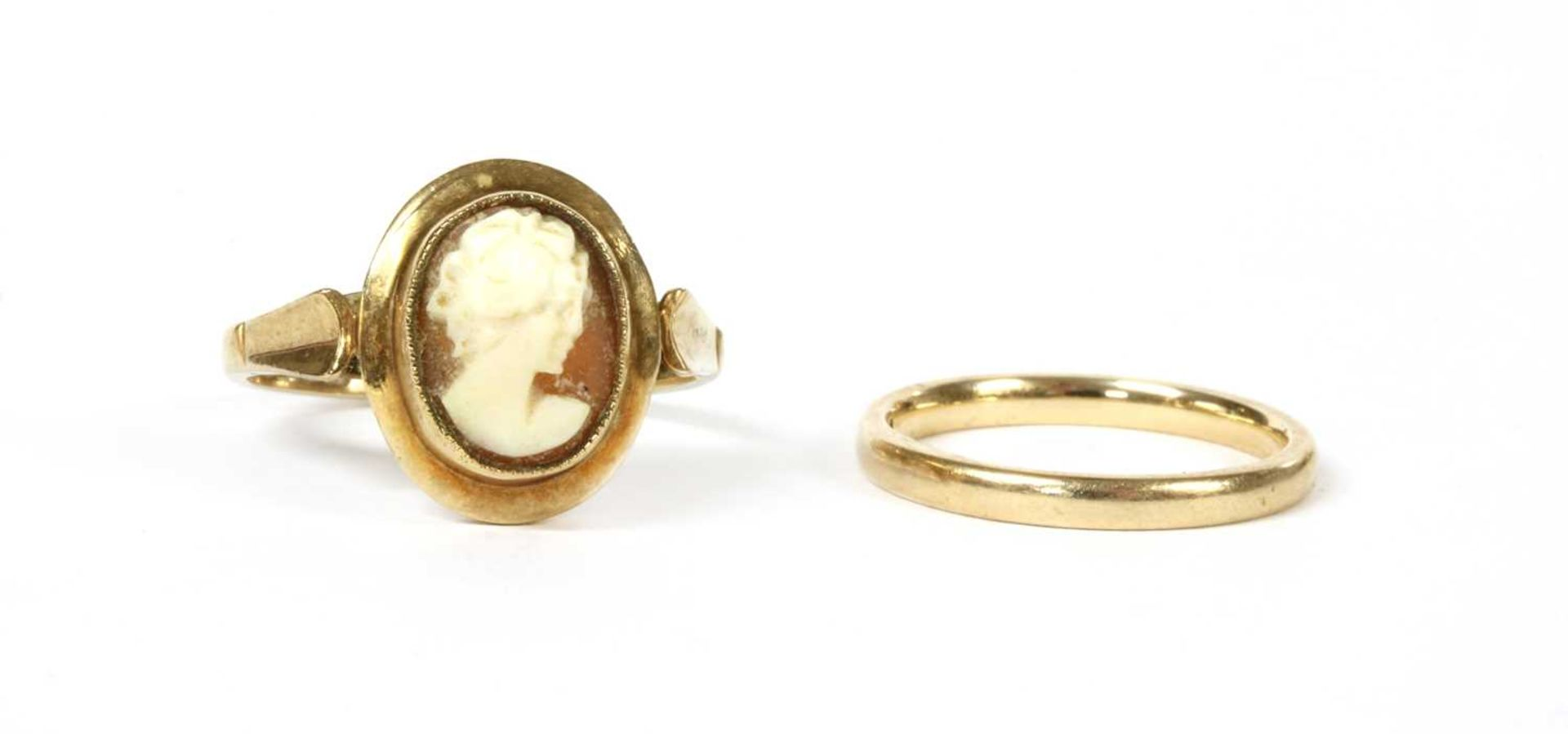 A 9ct gold court section wedding ring,