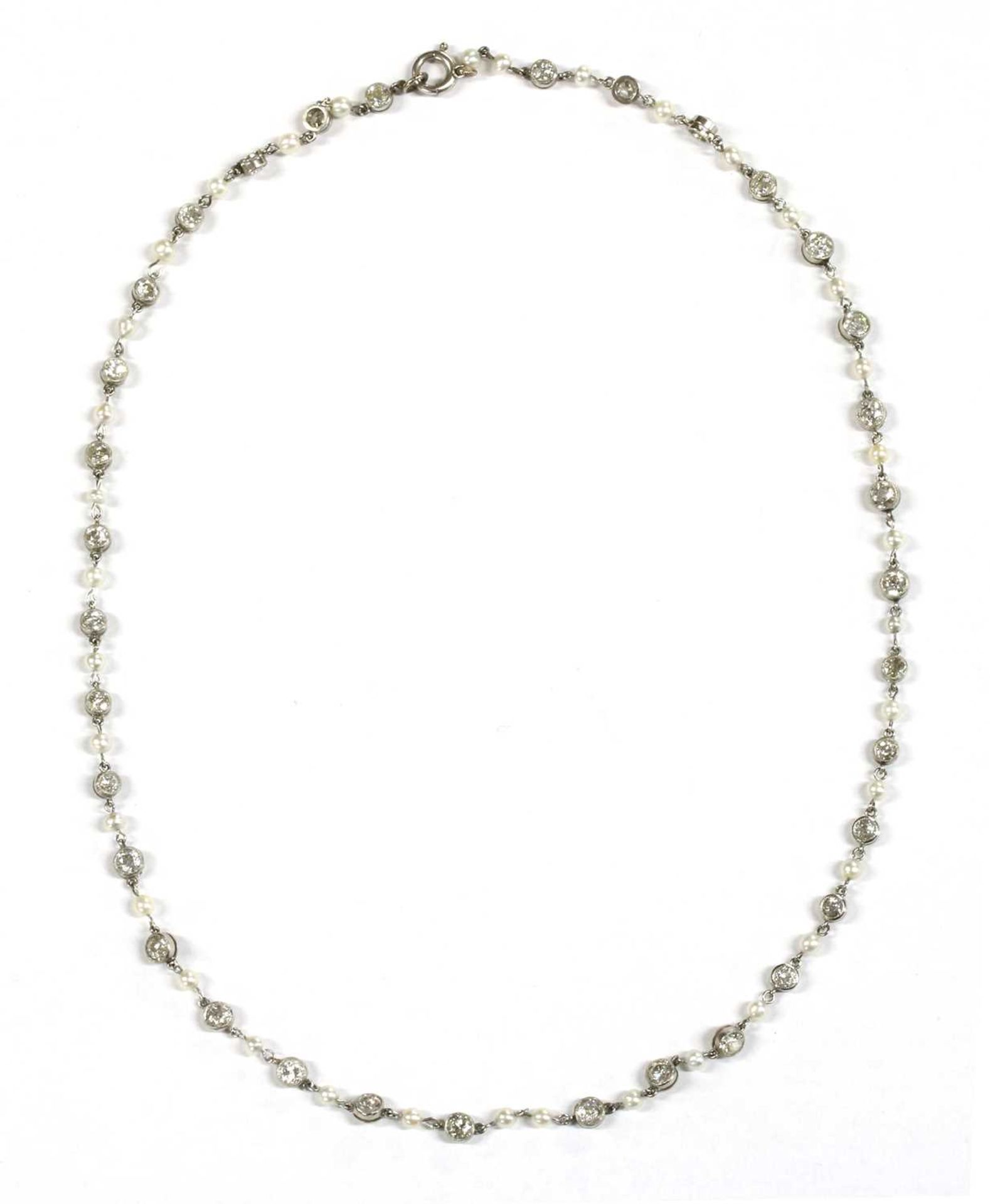 A platinum diamond and seed pearl necklace,