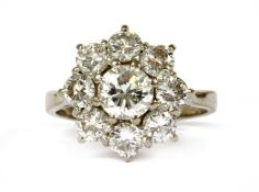 A white gold diamond cluster ring,