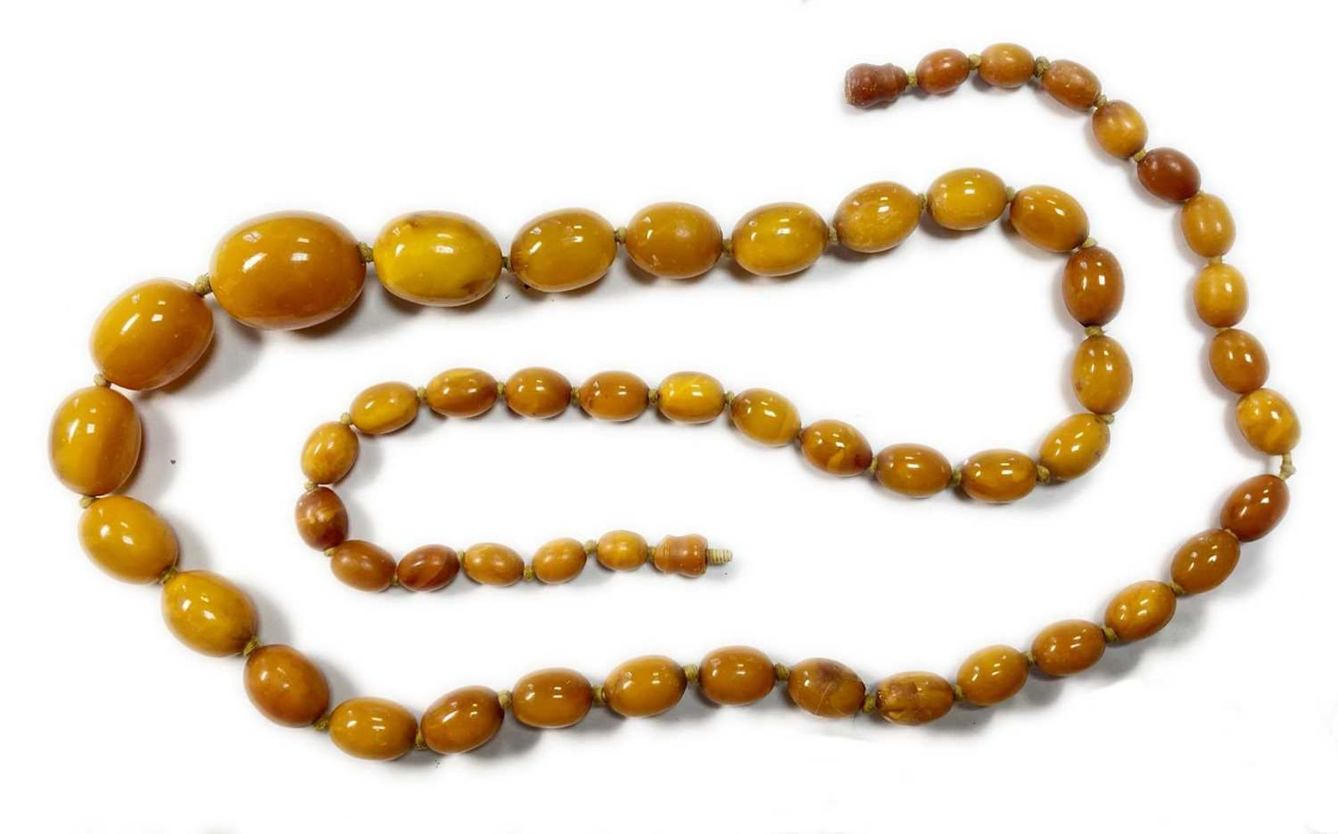 A single row graduated olive-shaped butterscotch amber bead necklace, - Image 12 of 12