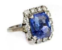 An American sapphire and diamond cushion-shaped cluster ring,