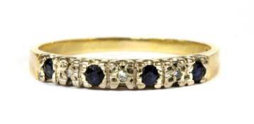 A gold sapphire and diamond ring,