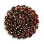 A Victorian circular Bohemian garnet brooch,