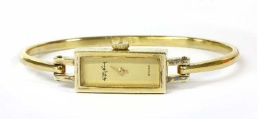 A silver gilt Roy King mechanical bangle watch,