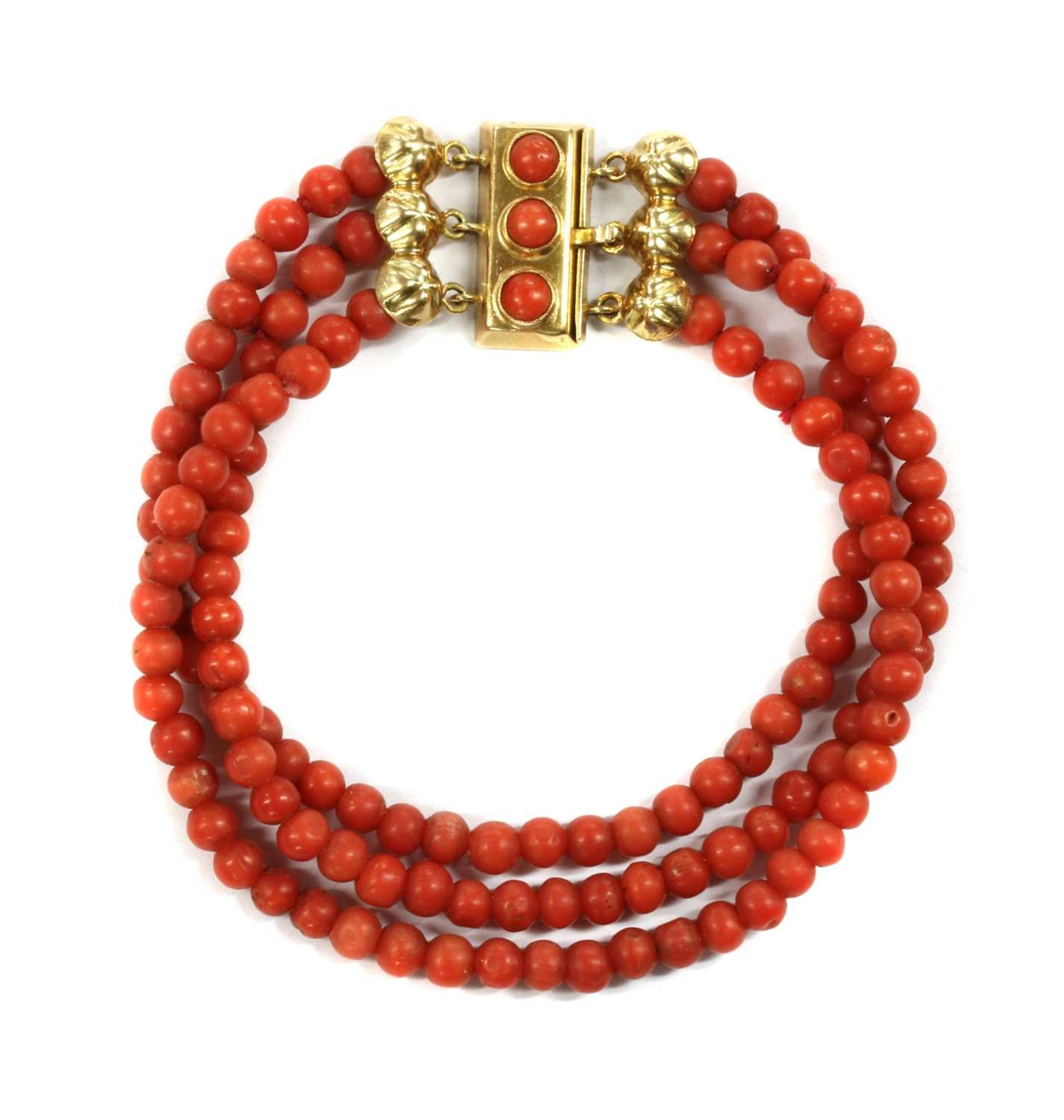 A three row uniform coral bead bracelet,