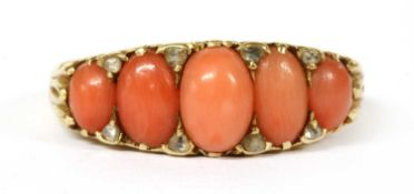 A Victorian gold five stone coral and diamond ring,