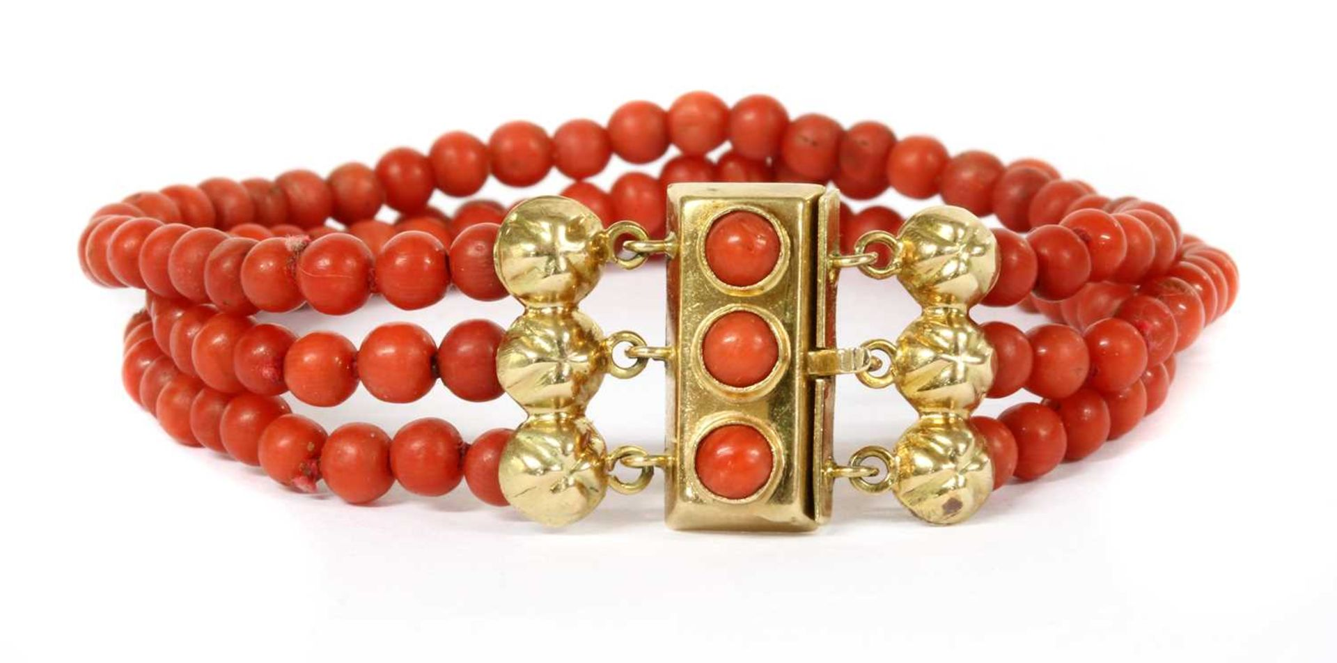 A three row uniform coral bead bracelet, - Image 2 of 2