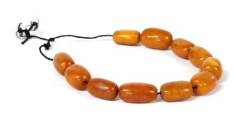 Eleven butterscotch amber beads,