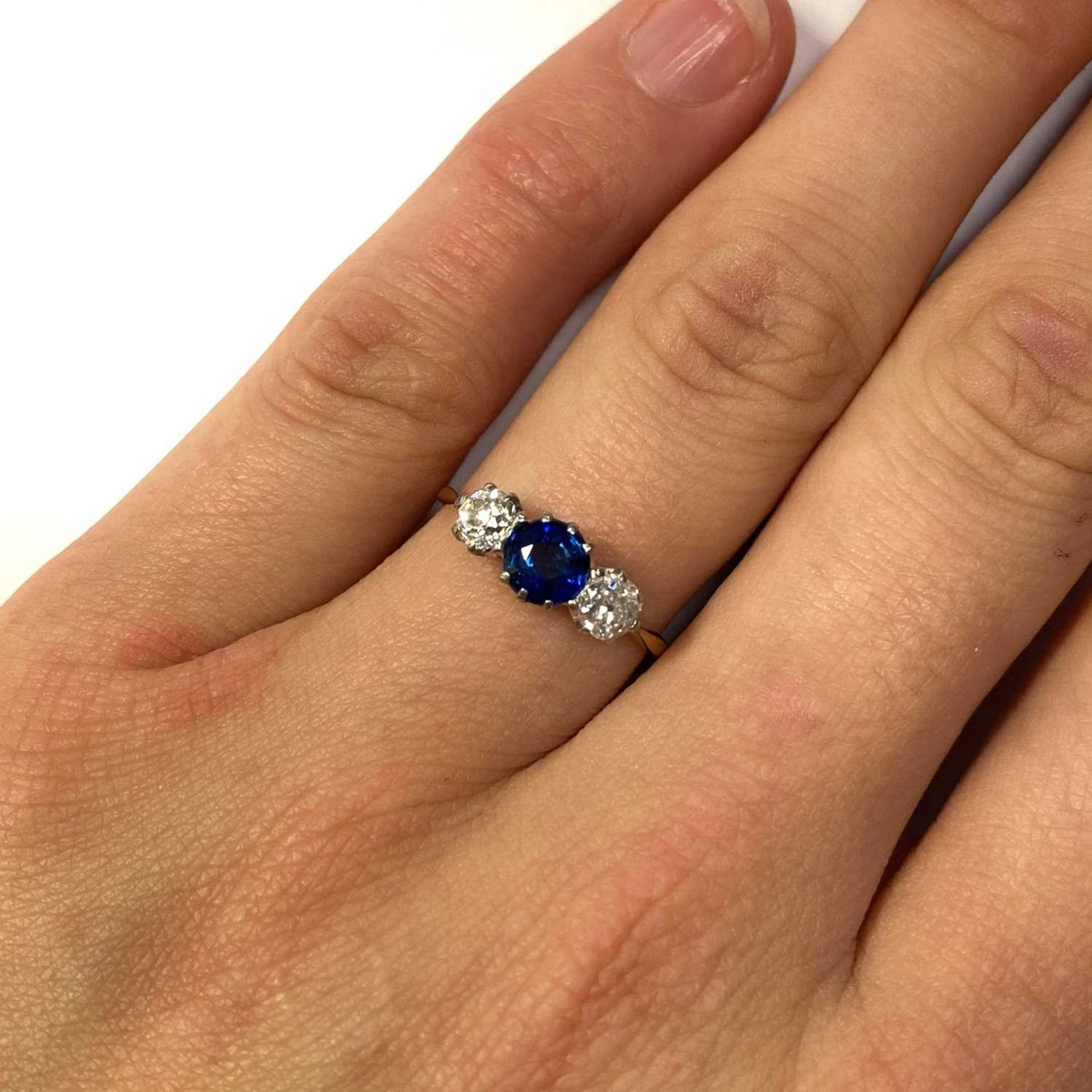 A gold three stone sapphire and diamond ring, - Image 4 of 4