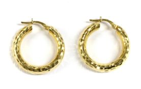 A pair of Italian gold hoop earrings,