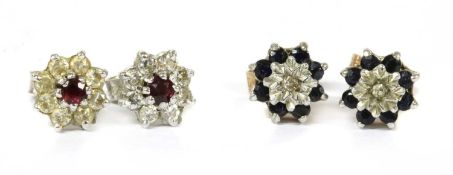 A pair of white gold ruby and diamond cluster earrings,
