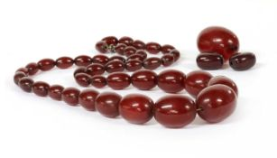 A single row graduated cherry coloured Bakelite bead necklace,