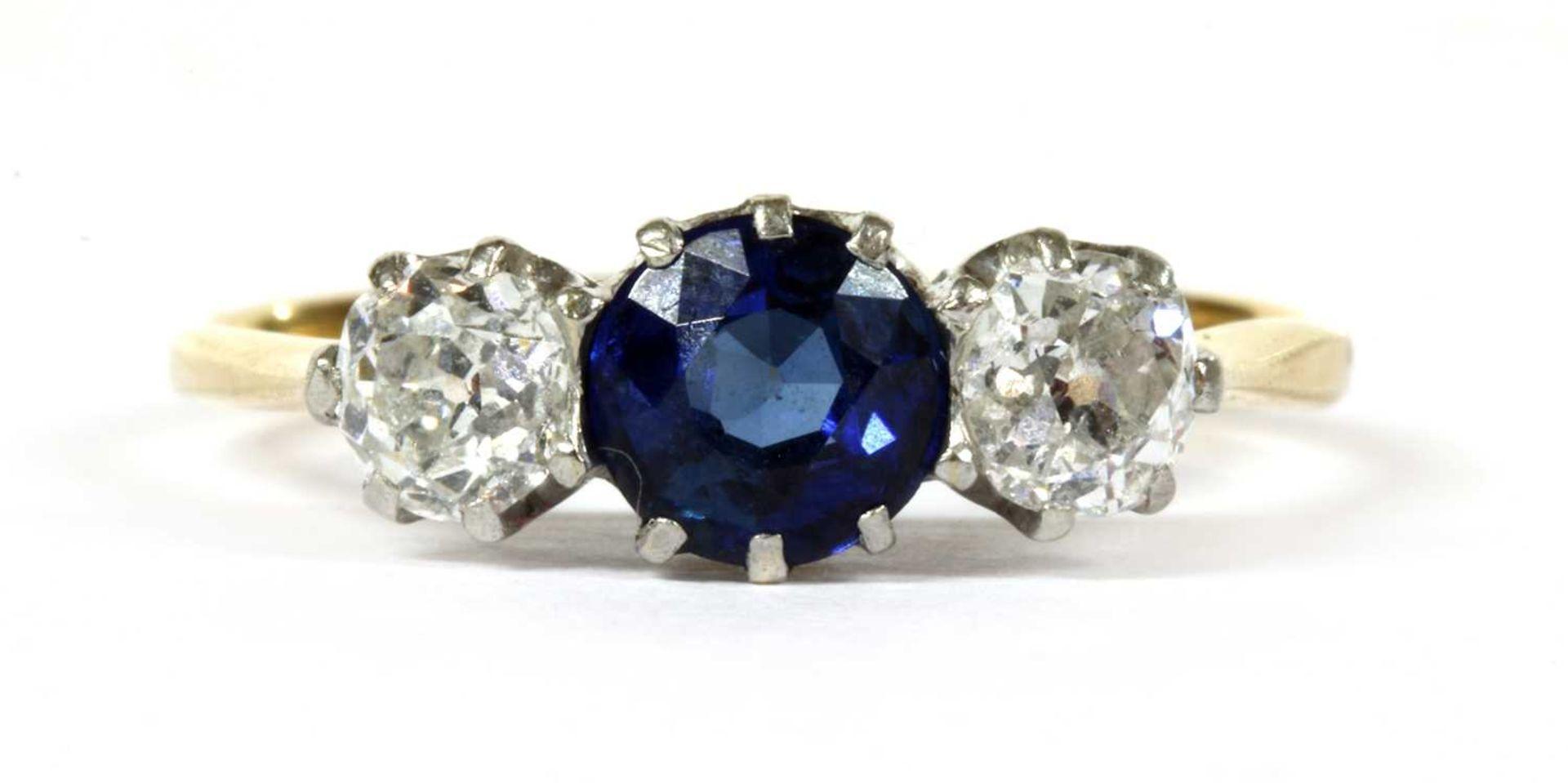 A gold three stone sapphire and diamond ring,