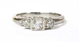 A 9ct white gold three stone diamond ring,