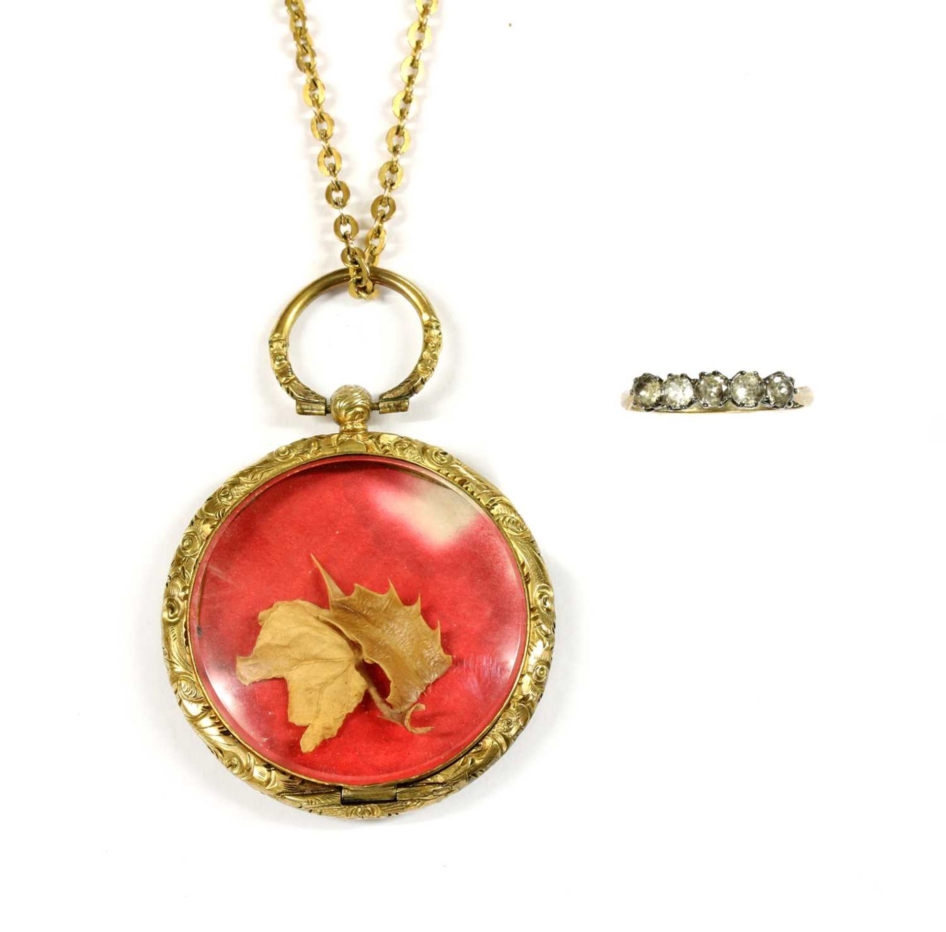A gilt metal photo locket,