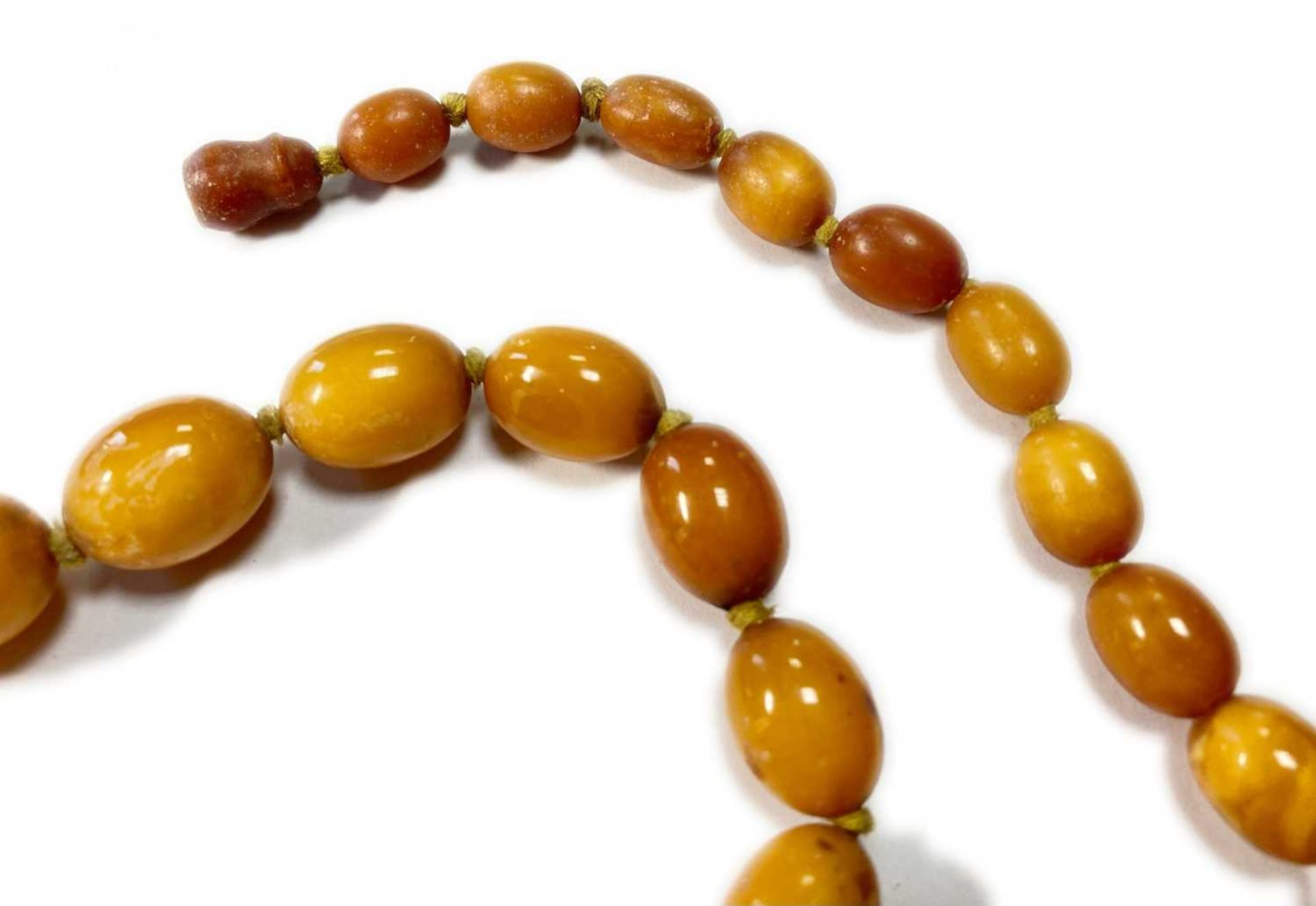 A single row graduated olive-shaped butterscotch amber bead necklace, - Image 5 of 12