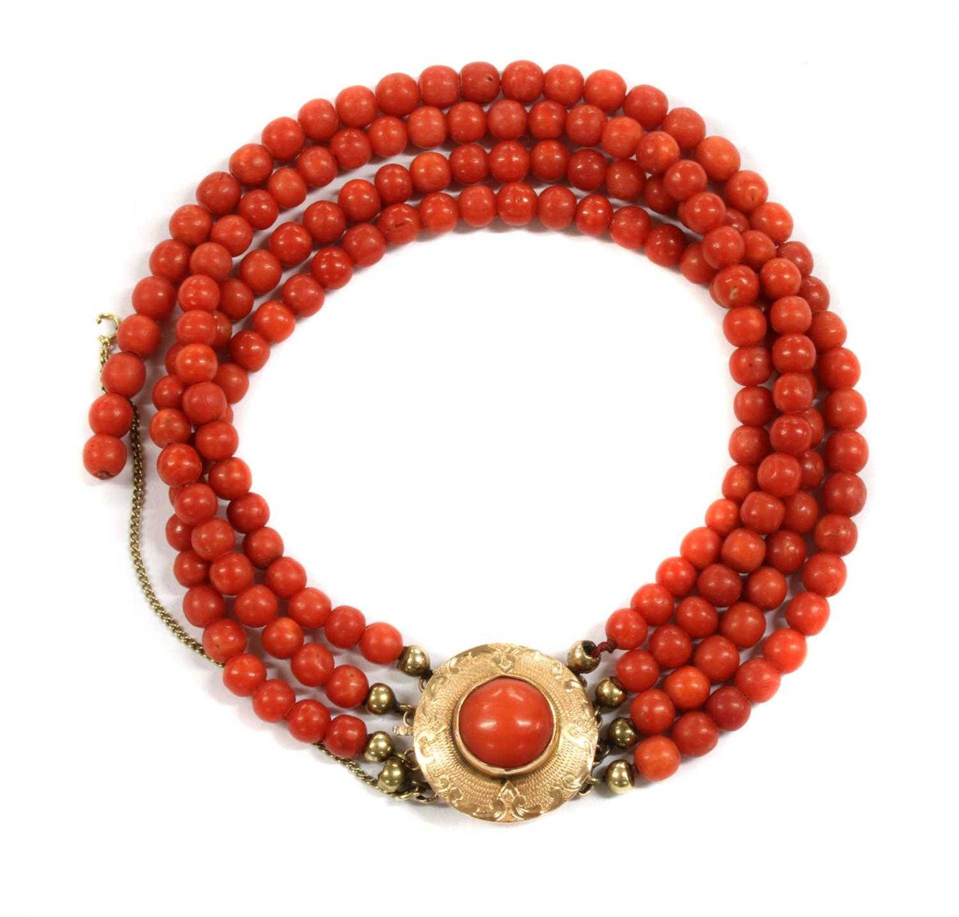 A Dutch four row coral bead bracelet,