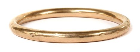 A 9ct gold bangle,