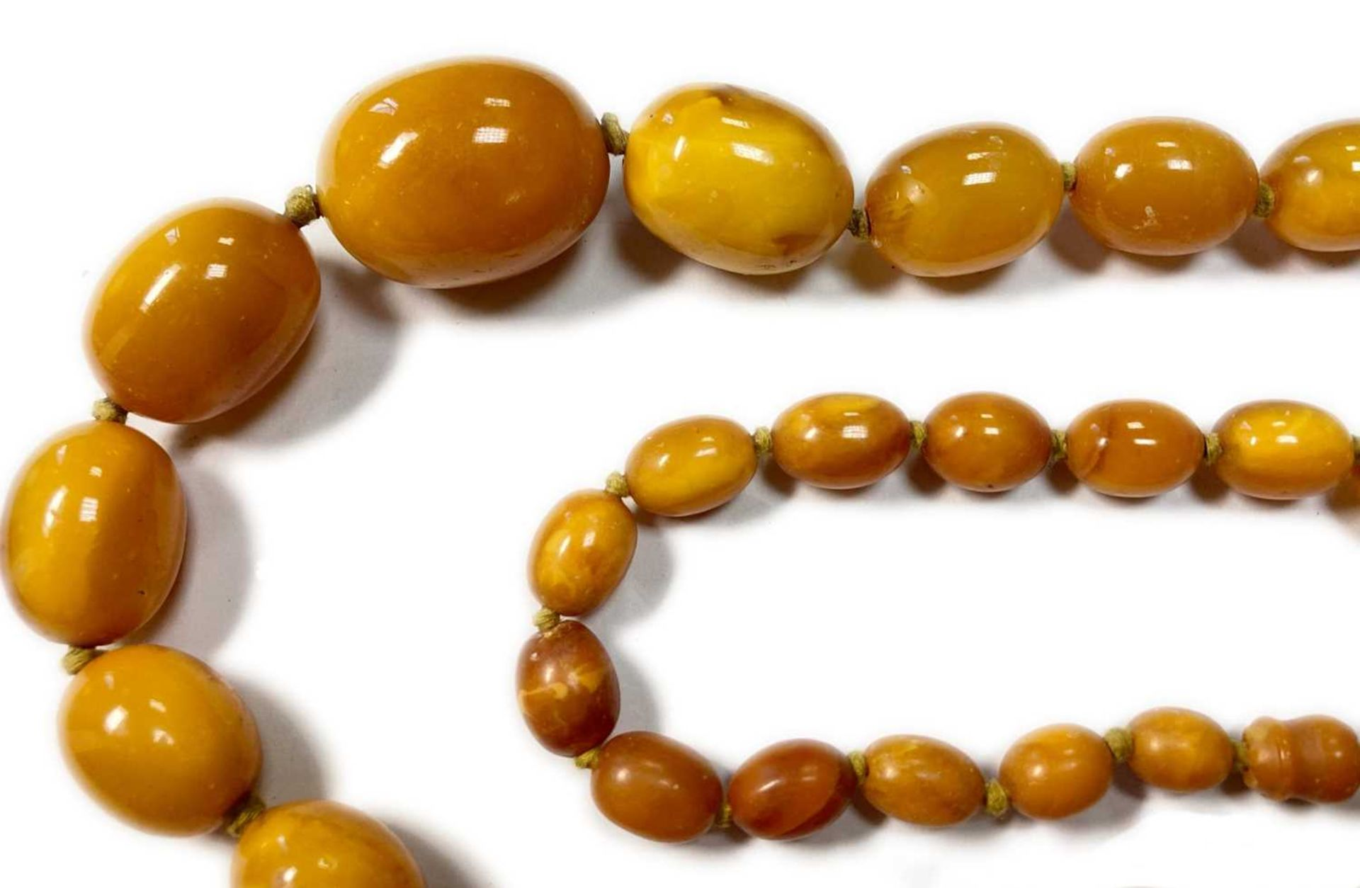 A single row graduated olive-shaped butterscotch amber bead necklace, - Image 9 of 12
