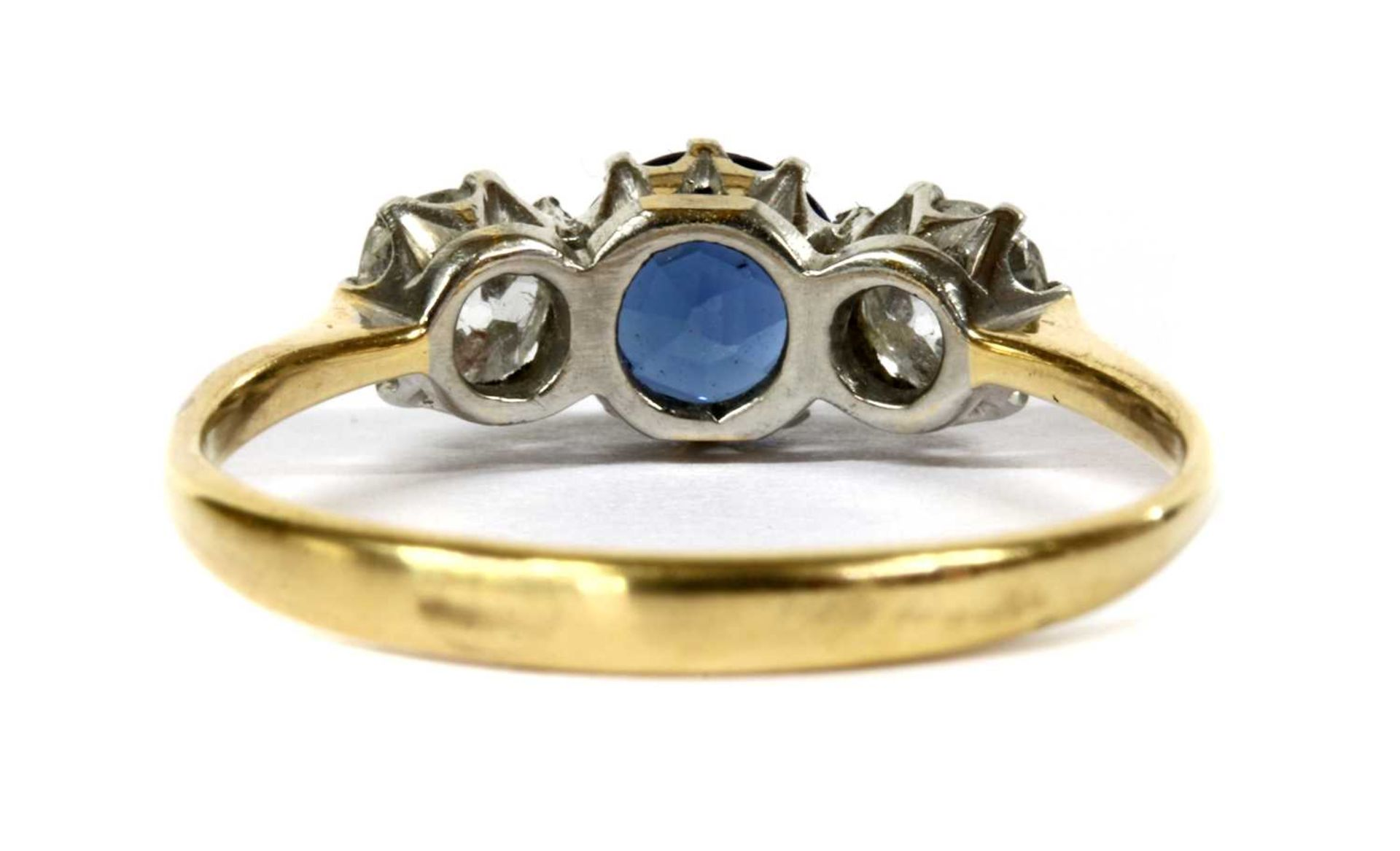 A gold three stone sapphire and diamond ring, - Image 2 of 4