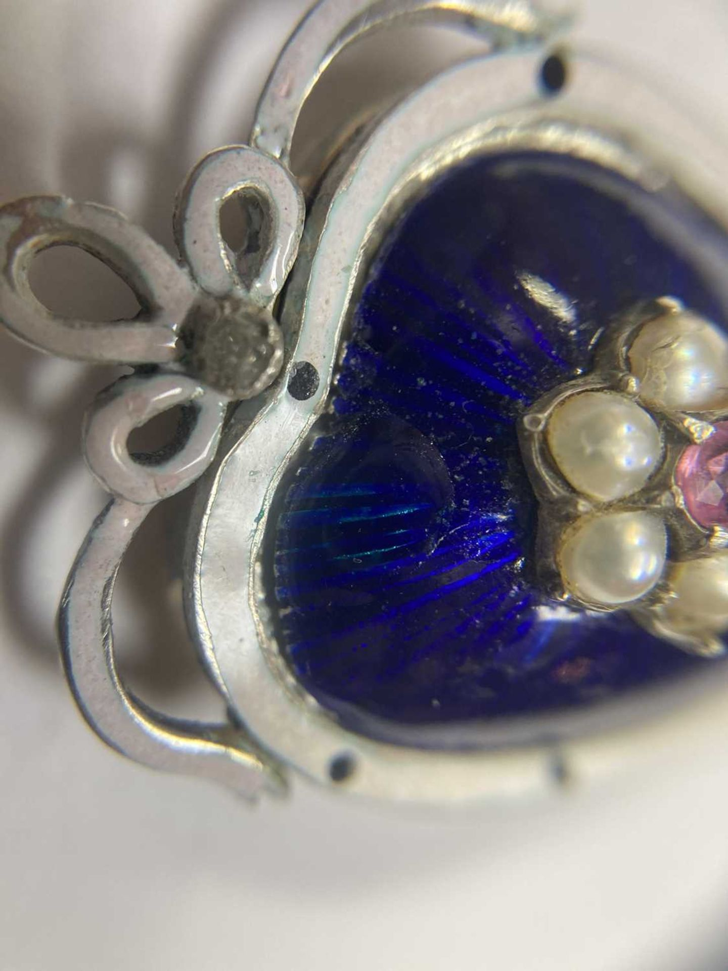 A gold and silver, ruby, split pearl, diamond and enamel heart pendant, - Image 8 of 9