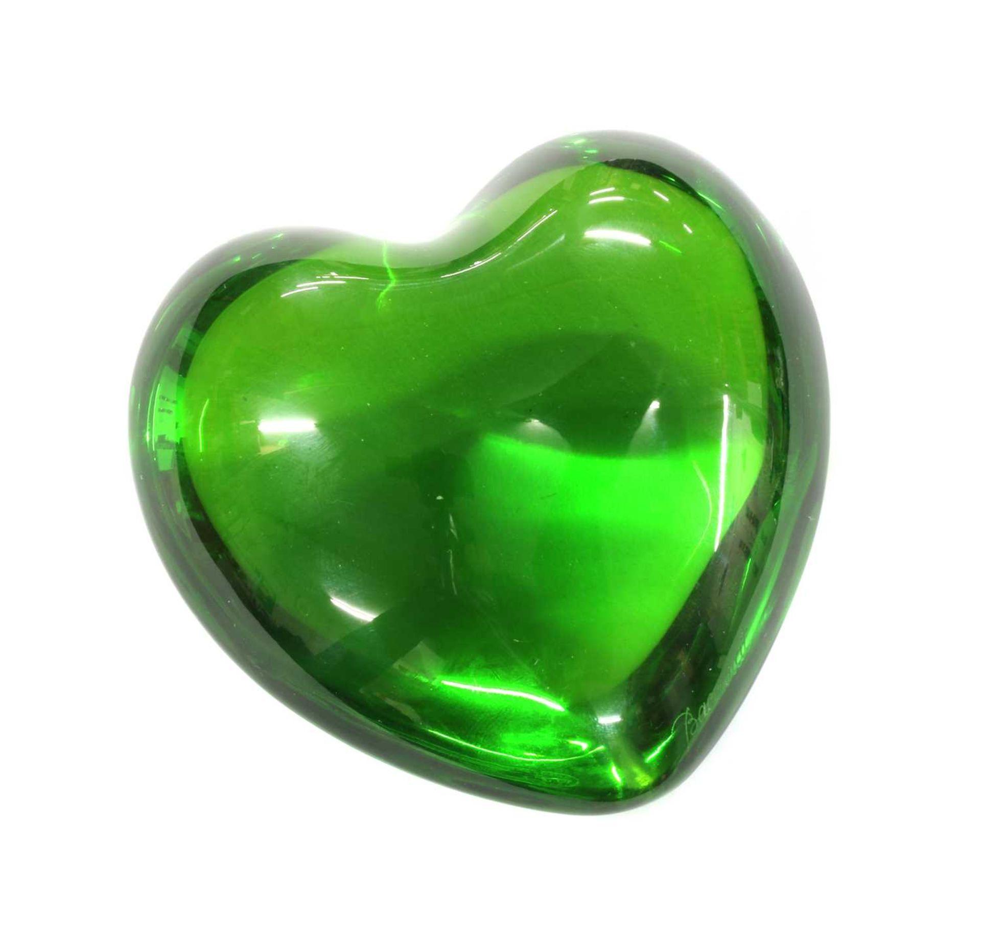 A green glass Baccarat paperweight,