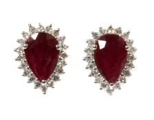 A pair of white gold ruby and diamond halo cluster earrings,