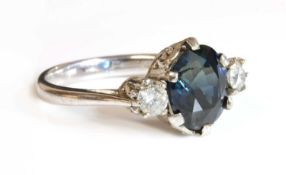 An 18ct white gold sapphire and diamond three stone ring,