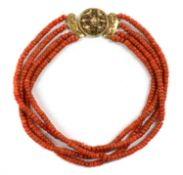 A Dutch four row uniform coral bead necklace,