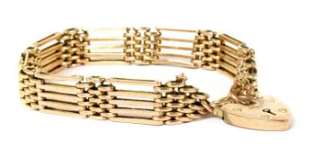 A gold five row gate bracelet,